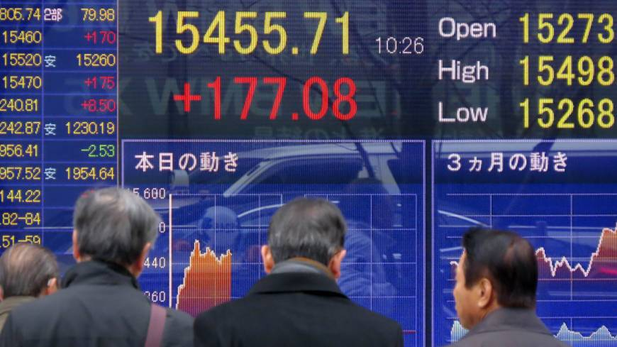 Keeping track: A quotation board in Tokyo displays the Nikkei 225 average in early trading Wednesday.