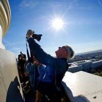 'Selfie' exposure: A photographer takes a shot of himself from the top of the U.S. Capitol on Dec. 19. | AFP-JIJI