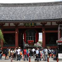 Crowd pleaser: Visitors stand in front of the gate to Sensoji Temple in Tokyo's Asakusa district in September. | BLOOMBERG