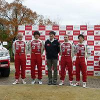 Race ready: Members of the Toyota team taking part in the 2014 Dakar Rally face the media Wednesday in Toyota, Aichi Prefecture. | KYODO