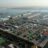 Seaworthy: Tokyo's Aomi Container Terminal, a major trading hub for the nation, thrives on Dec. 2. | BLOOMBERG