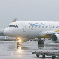 No frills: The first Vanilla Air flight sits at Narita International Airport before taking off for Naha, Okinawa Prefecture, on Friday morning. | KYODO