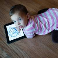 Li'l pixels: A 2-year-old colors with an iPad at her home in Middletown, Maryland. | THE WASHINGTON POST