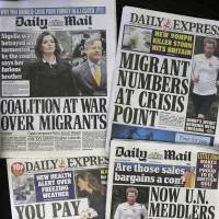Be afraid: Recent editions of Britain's middle-market Daily Express and Daily Mail newspapers feature headlines about immigration. | AP