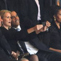 Snap happy: Danish Prime Minister Helle Thorning-Schmidt (center) poses with U.S. President Barack Obama (right) and British Prime Minister David Cameron for a 'selfie' during the memorial service for former South African leader Nelson Mandela in Johannesburg on Dec. 10 as Obama's wife, Michelle, looks on. | AFP-JIJI