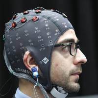 Make a wish: A man sends brain-computer interface commands in this file photo. The global advertising and marketing company JWT predicts that brain-computer interfaces, or BCIs, will push further into the commercial mainstream next year. | AP