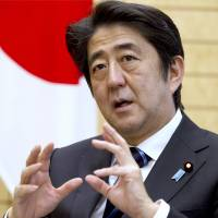 Pushing for wages: Prime Minister Shinzo Abe is interviewed in Tokyo on Friday. | BLOOMBERG