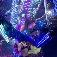 Bright lights, weird city: A woman performs on a swing atop a futuristic contraption during a show at the Robot Restaurant in Shinjuku, which boasts women in sci-fi lingerie interacting with people dressed as robots and other characters. Despite what the foreign media may have you believe, this is not a typical night out in  Tokyo. | AP