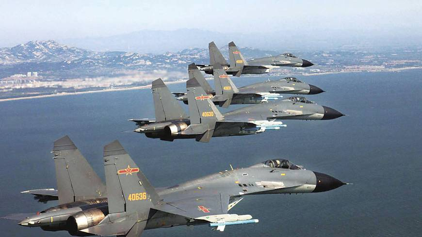 Flying in formation: Chinese Air Force pilots are seen taking part in a training flight in this file photo.