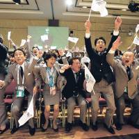 Nailed it: Japanese delegation members erupt in celebration Sept. 7 as International Olympic Committee President Jacques Rogge announces Tokyo will host the 2020 Summer Olympics. | AFP-JIJI