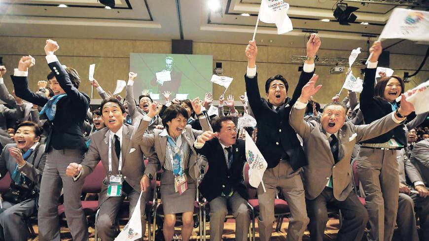 Nailed it: Japanese delegation members erupt in celebration Sept. 7 as International Olympic Committee President Jacques Rogge announces Tokyo will host the 2020 Summer Olympics.
