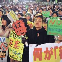 No secrets: Some 15,000 people gather in Hibiya, Tokyo, to protest the state secrets bill Dec. 6, the day the Diet passed it. | YOSHIAKI MIURA