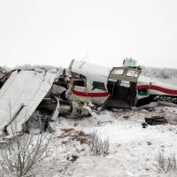 Wilderness tragedy: This image provided Saturday by Alaska State Troopers shows the wreckage of a plane that crashed Friday near Saint Marys. | AP