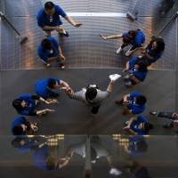 Bearing fruit: Chinese employees cheer a customer after he bought a new iPhone at an Apple store in Wangfujing shopping district in Beijing on Sept. 20.   AP