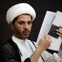 Arrested: Bahrain's Al-Wefaq opposition group leader Sheikh Ali Salman displays a document during a press conference in the village of Zinj, west of Manama, on July 4. | AFP-JIJI