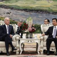 Biden in Beijing: U.S. Vice President Joe Biden (left) talks with Chinese Vice President Li Yuanchao at the Great Hall of the People on Wednesday in Beijing. | AP