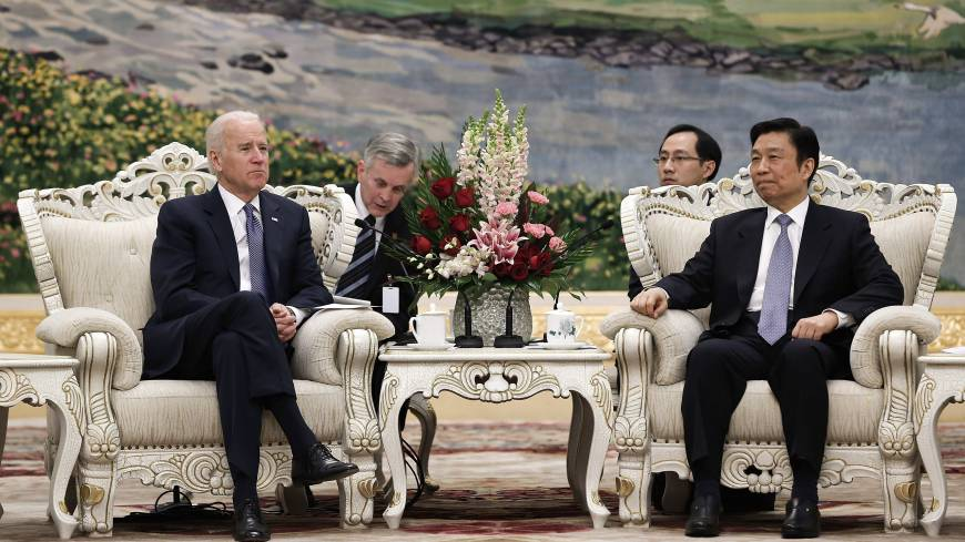 Biden in Beijing: U.S. Vice President Joe Biden (left) talks with Chinese Vice President Li Yuanchao at the Great Hall of the People on Wednesday in Beijing.