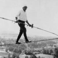 Lived to 82: French tightrope walker Henri Rechatin walks over the Saint-Remy sur Durolle countryside in central France on July 16, 1967, on his way to breaking the specialty's world record at the time. | AP