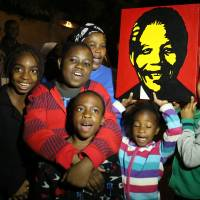 South Africans mourn, celebrate Mandela