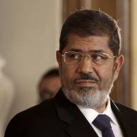 Deposed and accused: Egyptian President Mohammed Morsi holds a joint news conference with Tunisian President Moncef Marzouki at the presidential palace in Cairo on July 13, 2012. | AP