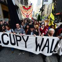 New strategy: Occupy Wall Street participants march down Fifth Avenue as part of May Day events in New York on May 1, 2012. | AFP-JIJI