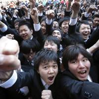 Searching for work: Vocational students raise their fists during a rally to kick off the job-hunting season in Tokyo in February. | BLOOMBERG