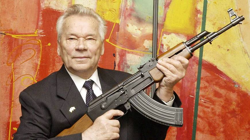 Accept no substitutes: Russian weapon designer Mikhail Kalashnikov presents his legendary assault rifle to the media while opening the exhibition 'Kalashnikov — legend and curse of a weapon' at a museum in Suhl, Germany, in July 2002. Kalashnikov died Monday at age 94.