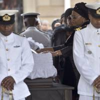Partner gone: Nelson Mandela's widow, Graca Machel, bids farewell to the former South African president as he lies in state at the Union Buildings in Pretoria on Wednesday. | AFP-JIJI