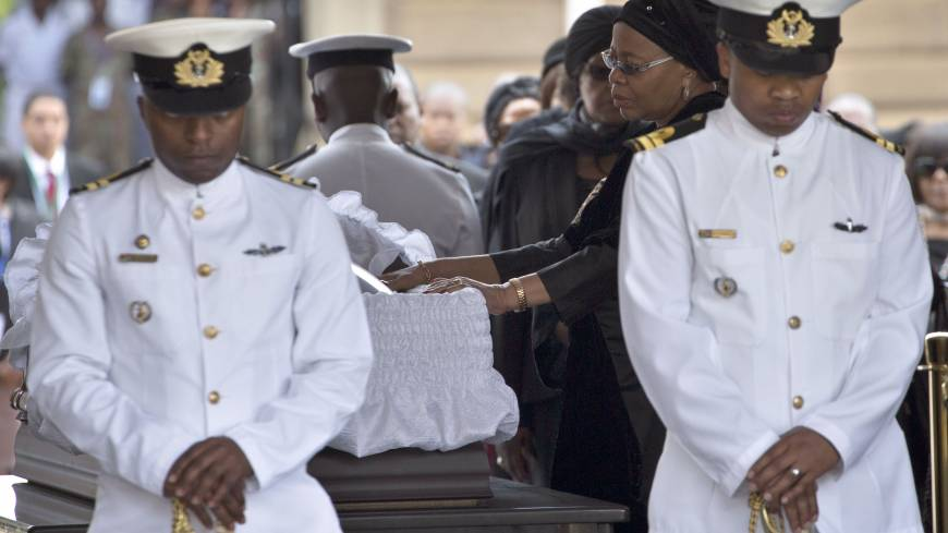 Partner gone: Nelson Mandela's widow, Graca Machel, bids farewell to the former South African president as he lies in state at the Union Buildings in Pretoria on Wednesday.