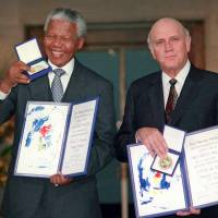 Unifiers: South African Deputy President F.W. de Klerk and South African President Nelson Mandela pose with their Nobel Peace Prize medals and diplomas in Oslo in December 1993. Mandela died Thursday at the age of 95. | AP