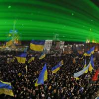 Position firm: Laser rays shine over pro-European Union activists during a rally in Independence Square in Kiev on Sunday. | AP