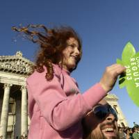 Going green: Supporters of a bill to legalize marijuana attend a rally outside Uruguay's Congress in Montevideo on Tuesday as the nation's Senate voted to create the world's first national marijuana market. | AP