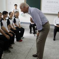 Old school: U.S. Vice President Joe Biden talks to students as Chinese Vice President Xi Jinping (second from right) watches during their August 2011 visit to Qingchengshan High School in Dujiangyan, in southwestern China's Sichuan province. | AP