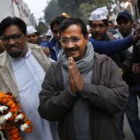Sweeping into office: Common Man Party leader Arvind Kejriwal greets supporters during a public meeting in New Delhi on Friday. | AFP-JIJI