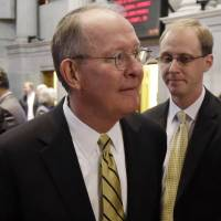 Disgraced: Sen. Lamar Alexander (left) leaves the Tennessee House of Representatives chamber with his chief of staff, Ryan Loskarn, in Nashville on Jan. 9. | AP