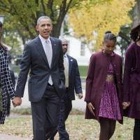 Moving on?: President Barack Obama, first lady Michelle Obama, and their daughters Malia (left) and Sasha walk from the White House in Washington, to attend a church service in late October. | AP