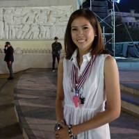 Reforming democracy?: Chitpas Bhirombhakdi, 27, a former Democrat Party spokeswoman, poses near a stage at the Democracy Monument, one the main anti-government rally sites in Bangkok, on Thursday. | AFP-JIJI