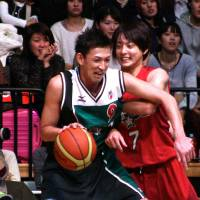 North star: Levanga Hokkaido's Takehiko Orimo attacks as Kei Igarashi of the Mitsubishi Electric Diamond Dolphins defends during the NBL All-Star Game at Ota City General Gymnasium on Sunday. | KAZ NAGATSUKA