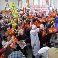 Okinawa base foes protest governor's OK of offshore fill work for Futenma replacement