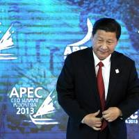 Intimidating: Chinese President Xi Jinping arrives for an event related to the Asia-Pacific Economic Cooperation forum in Bali, Indonesia, on Oct. 7. Beijing is denying it blocked a Bloomberg reporter from covering another event involving Premier Li Keqiang on Monday out of retaliation for unfavorable coverage. | BLOOMBERG