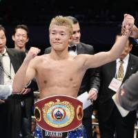 Proud winner: Bantamweight Tomoki Kameda wears his WBO bantamweight championship belt after Tuesday's bout in Osaka. | AFP-JIJI