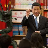 All smiles: Chinese Vice President Xi Jinping visits the International Studies Learning Center in South Gate, California. | BLOOMBERG