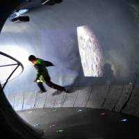 Moon mood: A boy runs in a moon exhibition room at an astronomy museum in Beijing on Wednesday. | AFP-JIJI