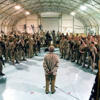 Rallying the troops: U.S. Secretary of Defense Chuck Hagel speaks with U.S. troops at Camp Bastion, Afghanistan, on Sunday to thank them for being deployed during the Thanksgiving holidays. | AP