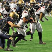 Workhorse: Fujitsu running back Yusuke Shinshi leads the team in carries (54) and rushing yards (481). | HIROSHI IKEZAWA