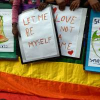 Opposed: Indian gay rights activists take part in a protest Sunday in Kolkata against a Supreme Court ruling that reinstated a ban on gay sex. India's government said Thursday it would look at ways to swiftly reverse the shock ruling, accusing the top court of dragging the country back to the 19th century. | AFP-JIJI