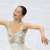 Career first: Akiko Suzuki grabs the title at the national championships on Monday at Saitama Super Arena, finishing first in the women's program with 215.18 points. | KYODO