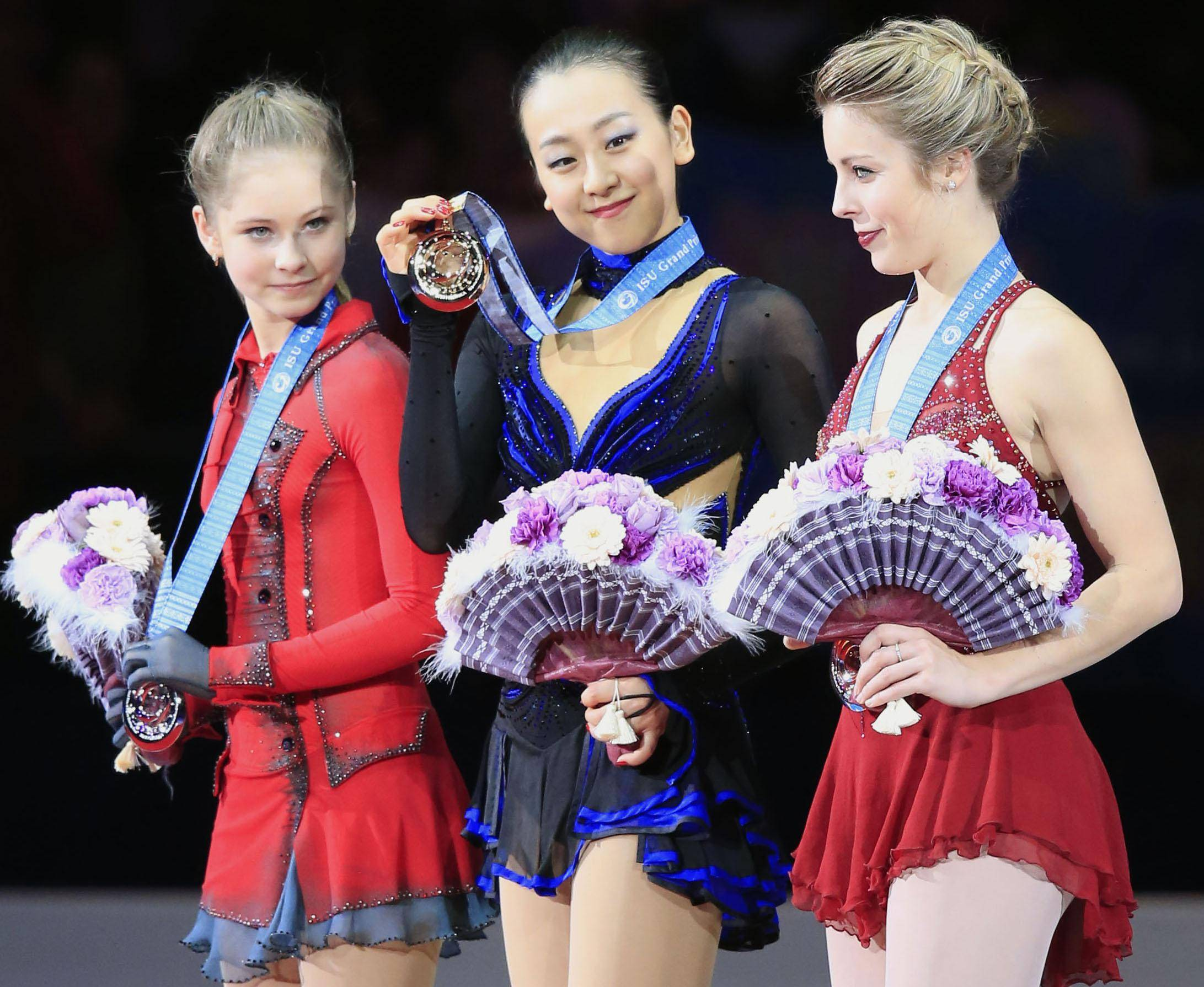 A reason for pride: Mao Asada (center) is joined by silver medalist Julia Lipnitskaia (left) and bronze medalist Ashley Wagner during the awards ceremony on Satuday night in Fukuoka. | KYODO