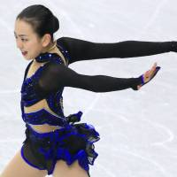 Disappointing finish: Mao Asada, a six-time national champion, places third at nationals behind Kanako Murakami and champion Akiko Suzuki. | KYODO