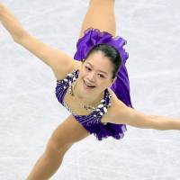 Satisfactory start: Akiko Suzuki is in second place after a solid showing in the short program. | KYODO